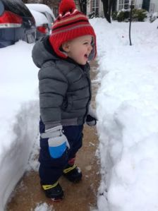 Yelling at the snow to let it know he is there.